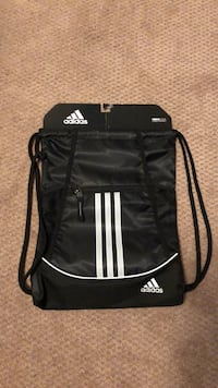 black and white Adidas backpack 30 km