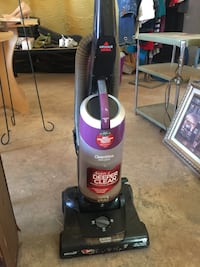 black and red Bissell upright vacuum cleaner Lubbock, 79407