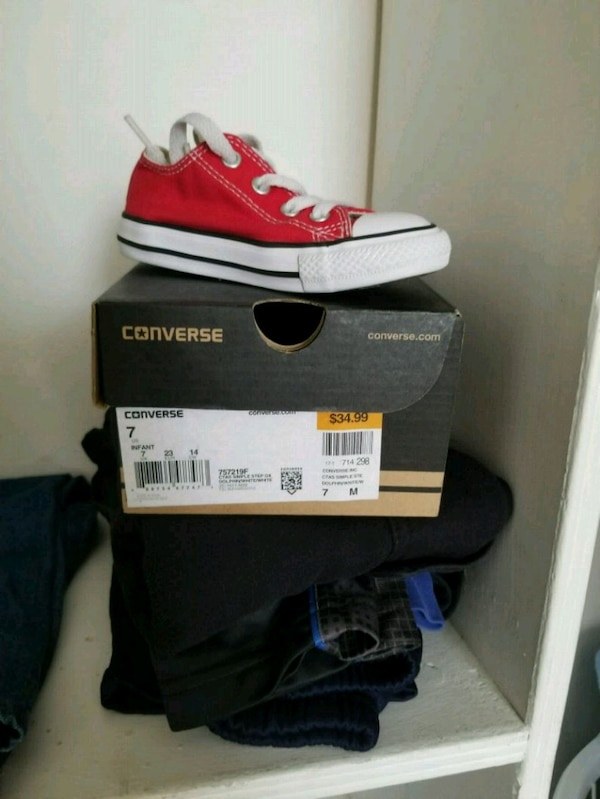 pair of red converse low-top sneakers with box