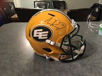 Edmonton Eskimos Riddell Football Helmet with Mike Reilly signature and authentic card $ 500.00 or best offer.