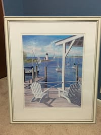 Two white lounge chairs and white lighthouse framed painting