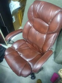 brown leather padded rolling armchair Nashville, 37217