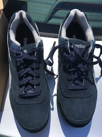 Brand new pair of blue-and-white Reebok steel toe safety sneakers
