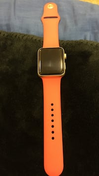 Gold-colored apple watch with red sports band Riverside, 92505