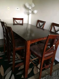 rectangular brown wooden table with six chairs din Edmonton, T5X 5G4