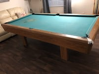 9 feet long pool table with pool balls Tampa, 33609