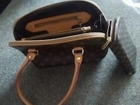 black and brown leather handbag Kelowna, V1X 7Z6