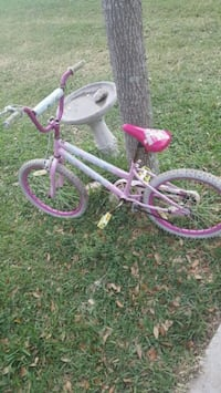 children's pink and white bicycle