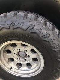 gray 6-lug vehicle wheel and tire 48 km