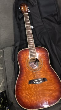 brown and black acoustic guitar in case Baltimore, 21229