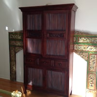 Brown real wood hand carved armoire/ cabinet great piece original for some lucky person. Paid 1500 Laval, H7K 3T4