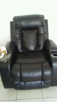 Leather Recliner still has the sale tags 745 mi