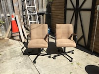 Suede leather rolling chairs with arm rests. $60. (Pair) London, N5V 1H6
