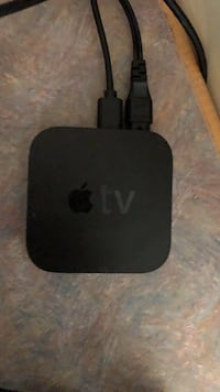 black Apple TV box with remote St Catharines, L2P 1A4