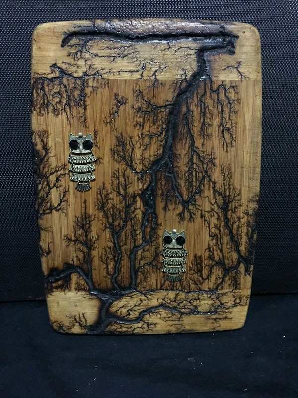brown and black wooden painting