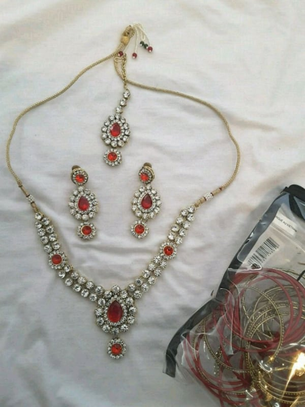 red and gold Indian  jewelry set d5e01147-d515-4dd1-ac8f-feb8b53f4ef7