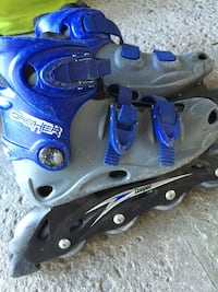 pair of blue inline skates Kirkland, H9J