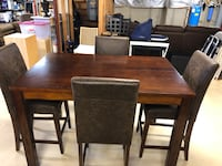 High top dining table and chairs. Table includes expanding leaf.  Baldwin, 21013
