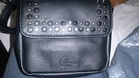 Celine Dion black studded leather around the waist London, N6H 1M9