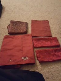 Red curtain, table runner, 2 place mats and center