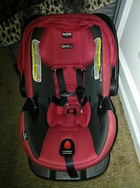 baby's red and black Britax car seat carrier