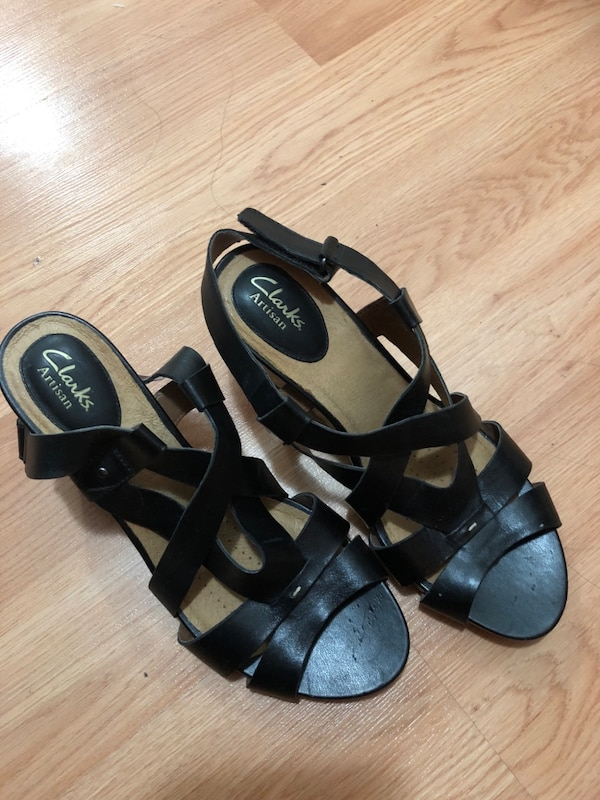 Pair of black leather open-toe sandals