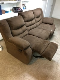 Brown sofa with recliners on both ends