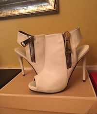 pair of women's white leather side-zip peep-toe heeled sandals
