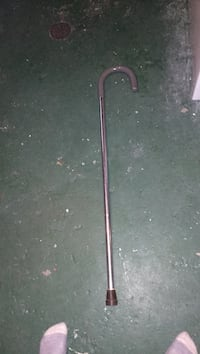 grey and stainless steel walking cane