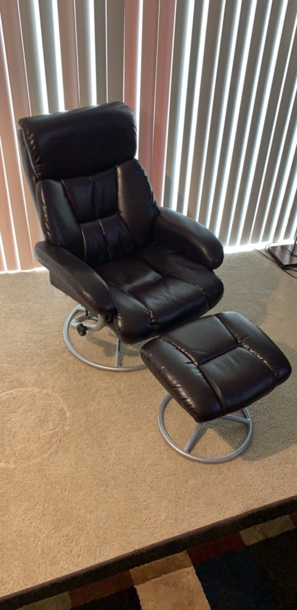 Black faux leather reclining armchair