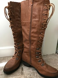 Pair of brown leather knee-high boots Vancouver, V6E 0B3
