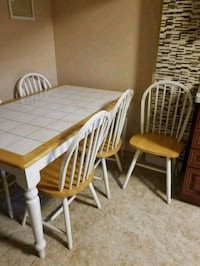 rectangular white wooden table with five chairs di 538 km