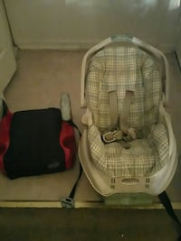 baby's gray and white car seat carrier
