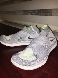 pair of gray-and-white Nike running shoes Vancouver, V6L 1T4