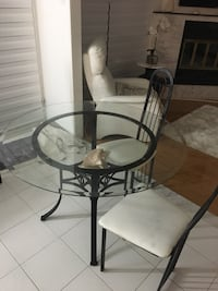 round glass top table with black metal base Montréal, H4M 1K6