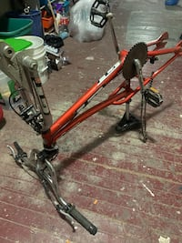 red and black full suspension mountain bike New York, 10467