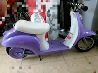 purple and white motor scooter 1294 mi