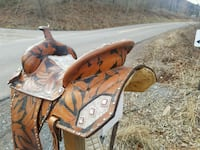 brown and black leather floral horse saddle
