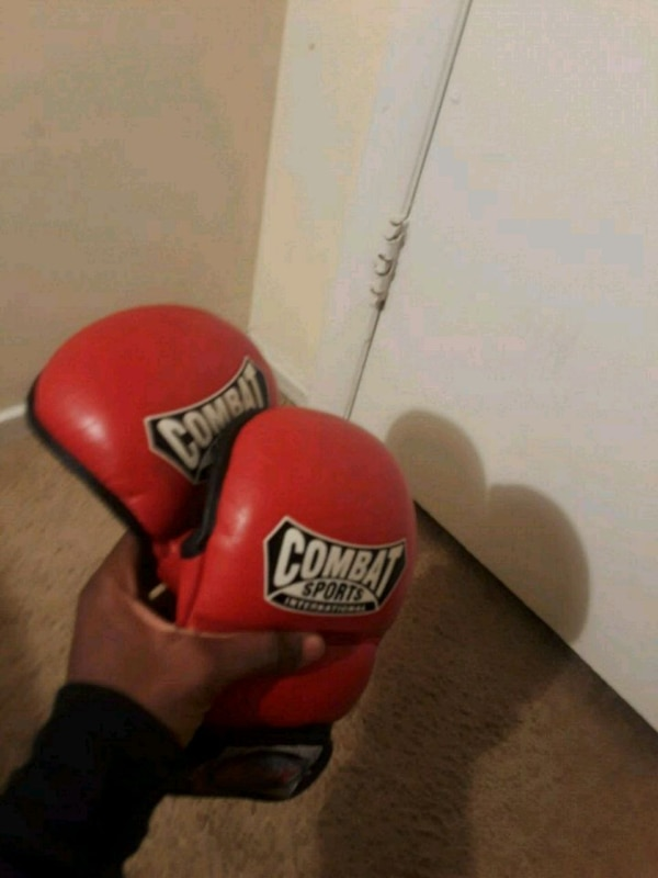 red and black Everlast mma training gloves