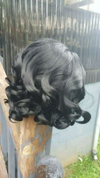 New black curley wig.