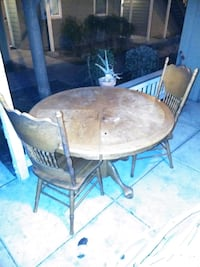 round brown wooden table with four chairs dining s Tracy, 95376