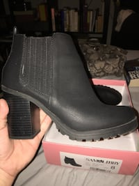 Pair of black leather booties Annandale, 22003