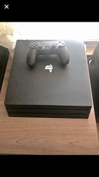 black Sony PS4 console with controller Anderson, 29626