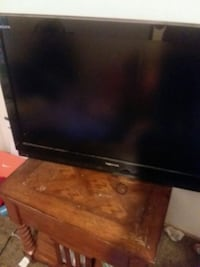 black flat screen TV with remote Conway, 29526
