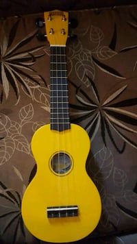 yellow and brown acoustic guitar Calgary, T2A 7J5