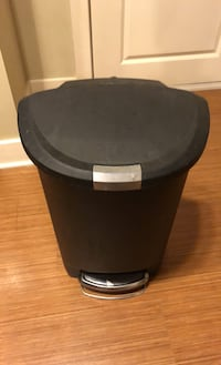 Large trash can with step to open