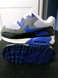 pair of black-and-blue Nike running shoes