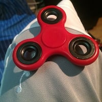 red and black fidget spinner Mississauga, L5J 4B6