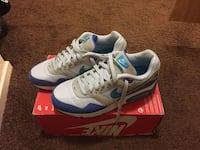 Pair of white, blue and purple Nike running shoes Stockton, 95206