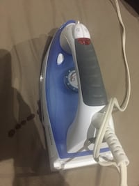 Working iron for ironing clothes